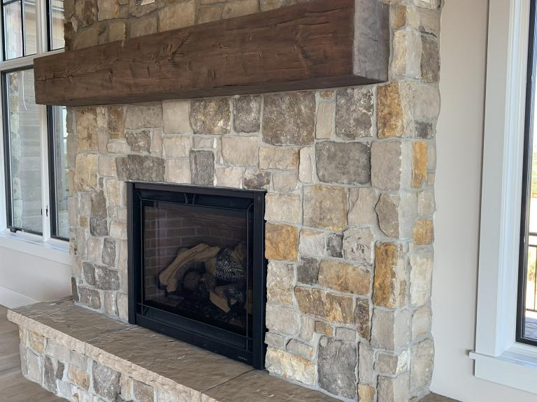 Greystone Fireplace With Buff Hearth